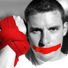 Man gagged - Red tape on