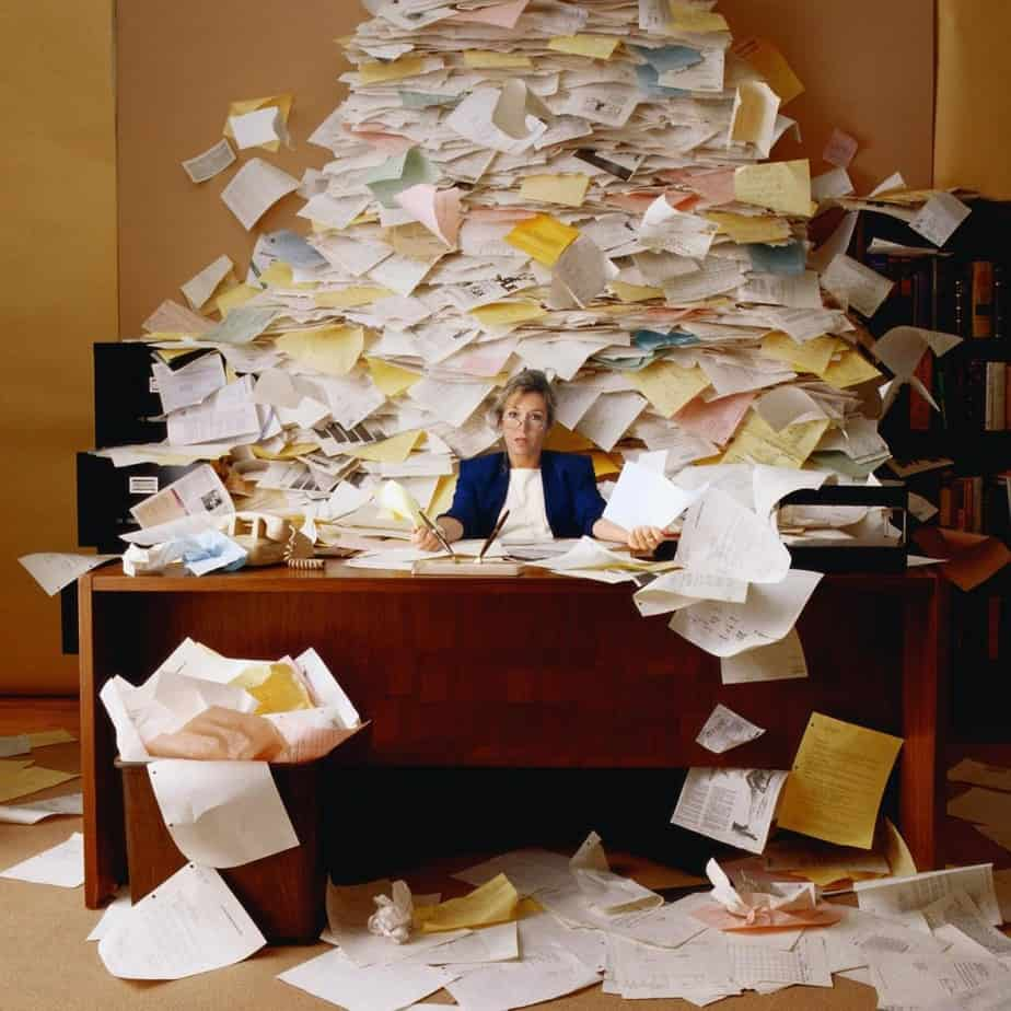 Piles of paper on a desk - Overwork