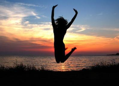 Woman jumping in the air in excitment